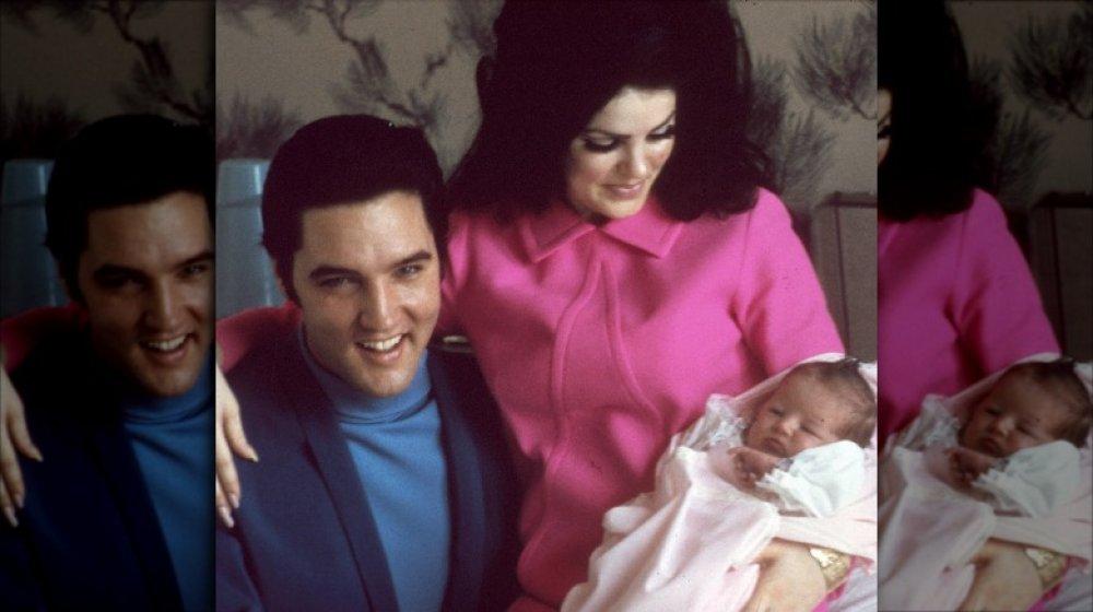 Elvis y Priscilla Presley sosteniendo a Lisa Marie como un bebé