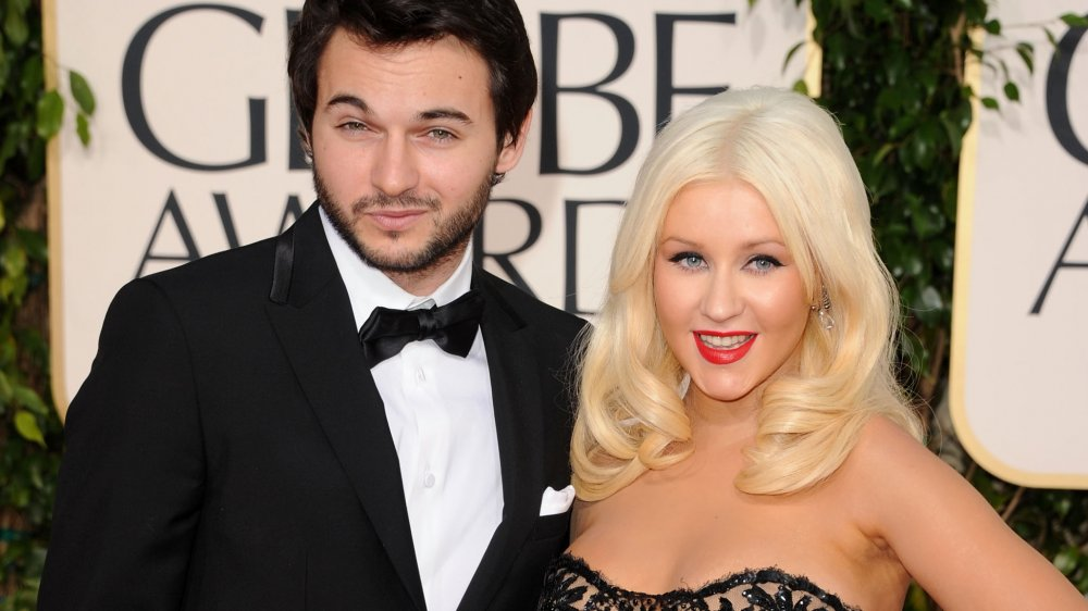 Matthew Rutler and Christina Aguilera on the red carpet at the Golden Globes
