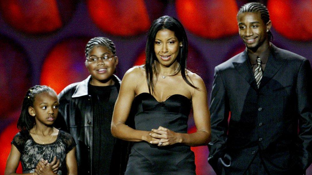 Elisa, EJ, Cookie y Andre Johnson en el escenario