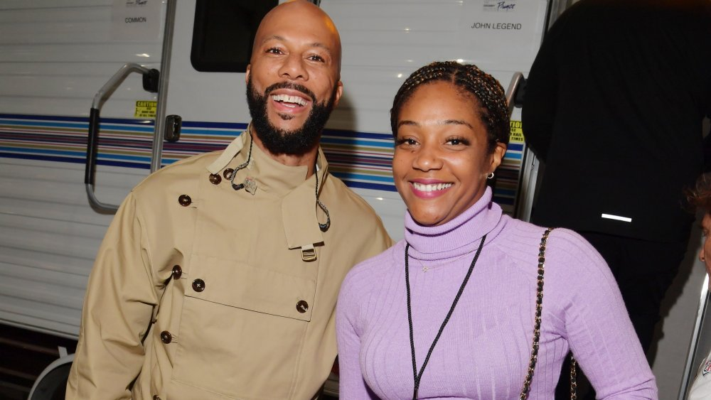 Common y Tiffany Haddish sonriendo juntos