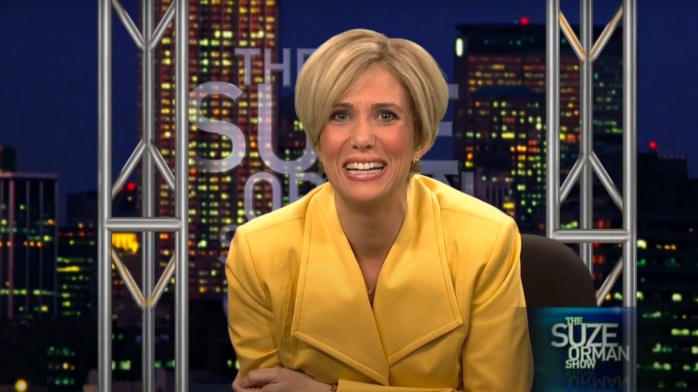 Kristen Wiig como Suze Orman en Saturday Night Live