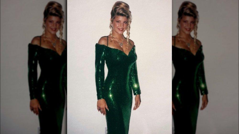 Stacy Ferguson con un vestido de fiesta verde