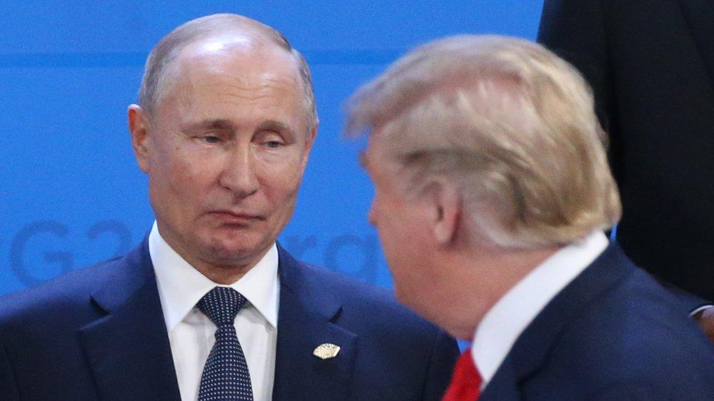 Vladimir Putin y Donald Trump en un evento de la Cumbre del G20 en 2018