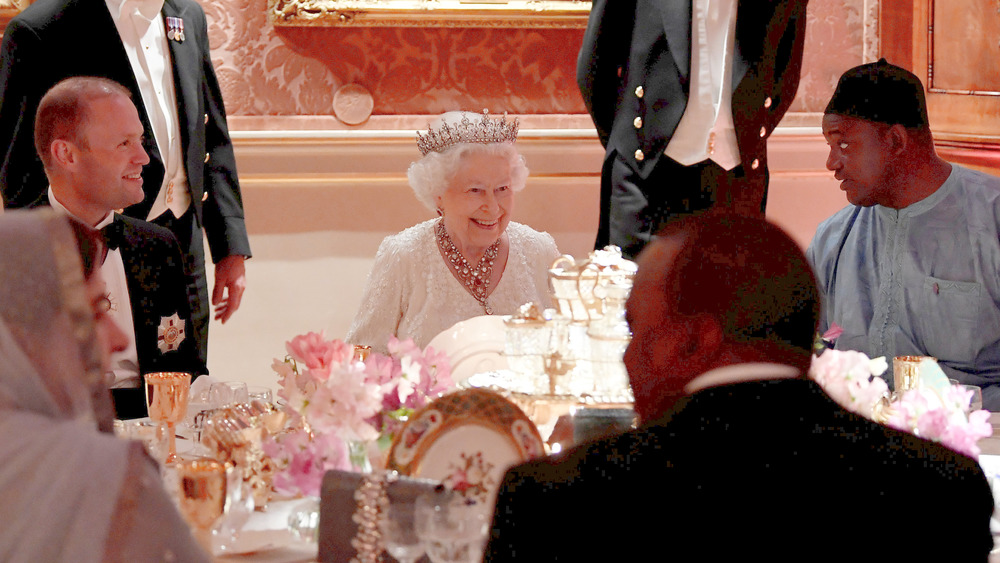 Reina Isabel en la cena