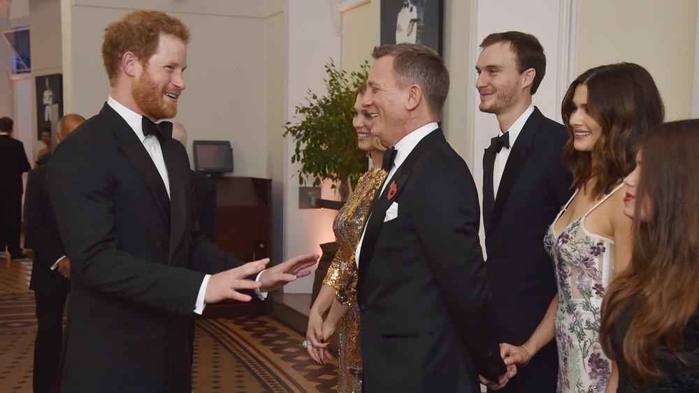 Príncipe Harry, Daniel Craig y Rachel Weisz