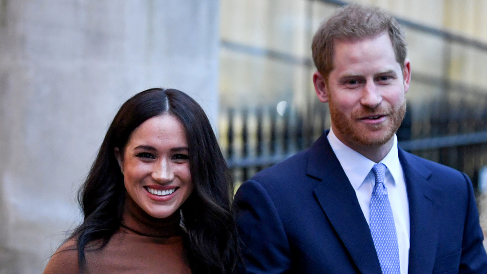 El príncipe Harry y Meghan Markle sonriendo