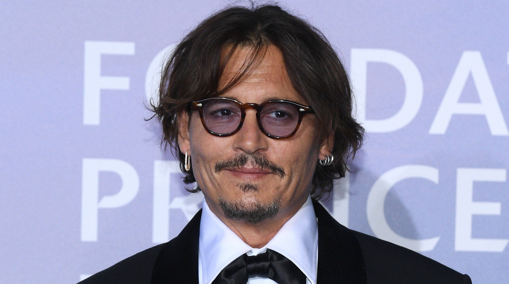 Johnny Depp posa en un evento