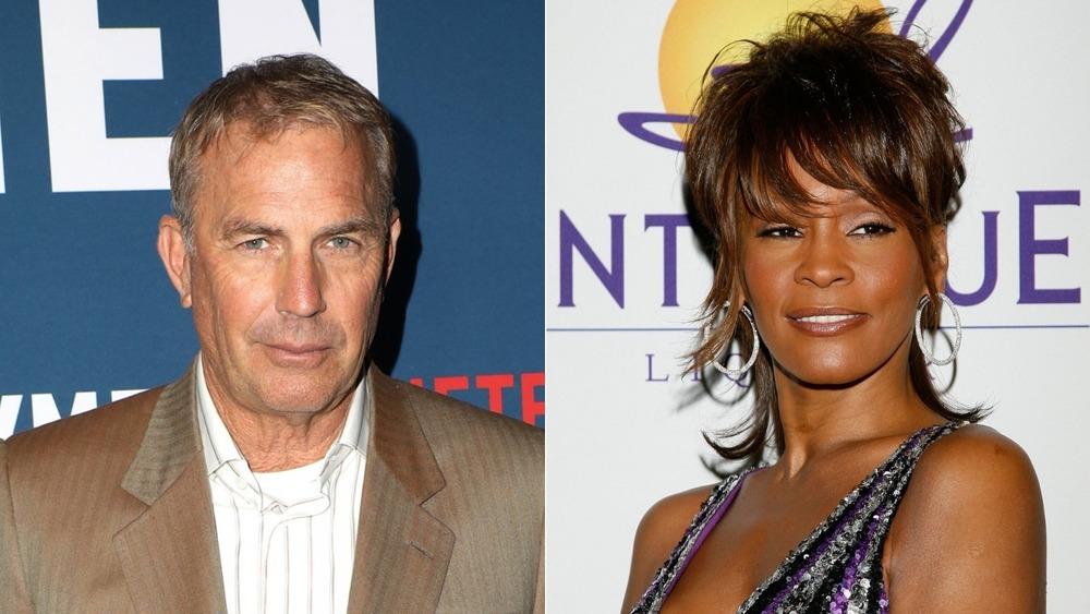 Kevin Costner y Whitney Houston posando en la alfombra roja