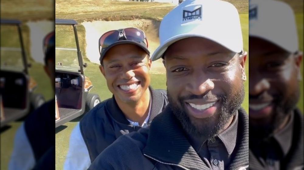 Dwyane Wade Tiger Woods sonriendo
