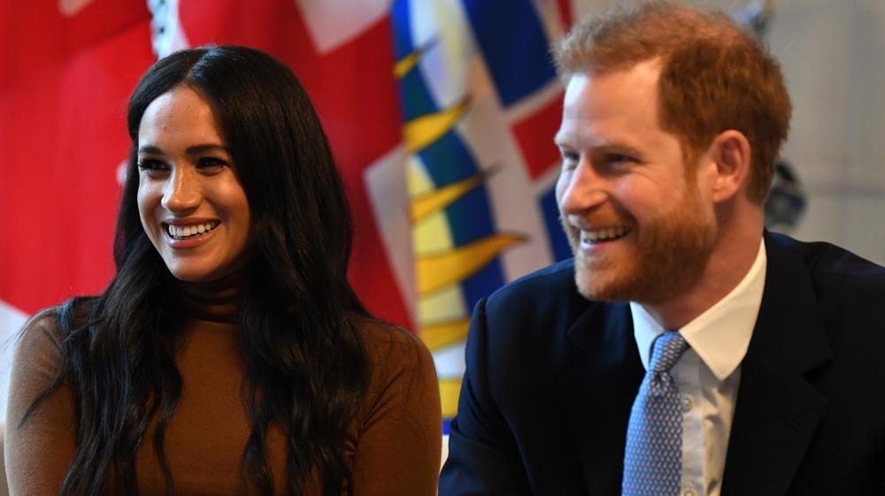 El príncipe Harry Meghan Markle riendo