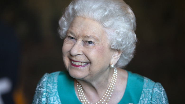 La reina Isabel sonriendo en la recepción de 2018