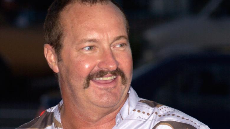 Randy Quaid sonriendo