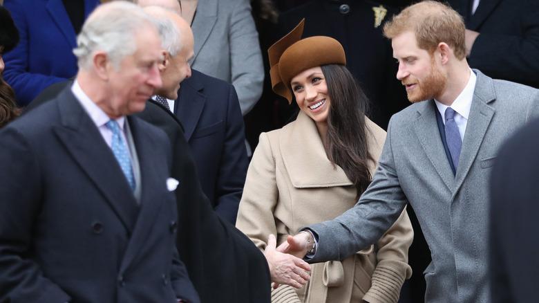 Príncipe Carlos, Meghan Markle y Príncipe Harry