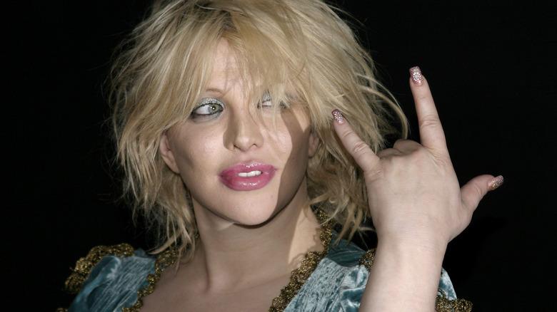 Signo de rock and roll de Courtney Love