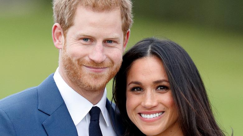 Meghan Markle, el príncipe Harry, ambos sonriendo