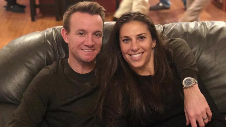 Carli Lloyd y Brian Hollins