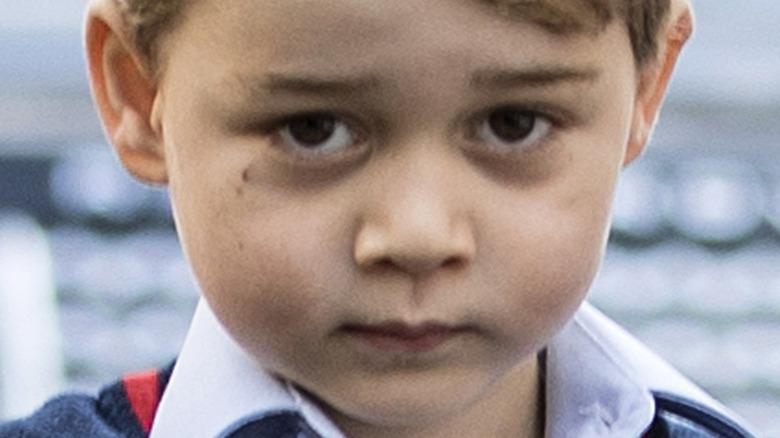 Prince George ojos marrones