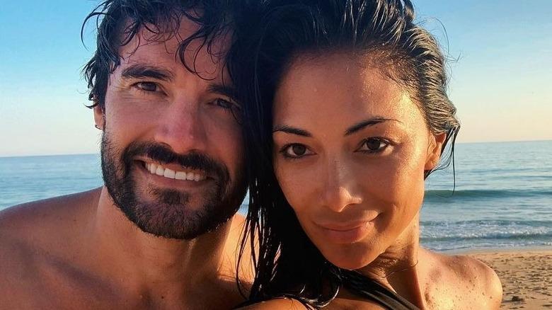 Nicole Scherzinger con Thom Evans en la playa